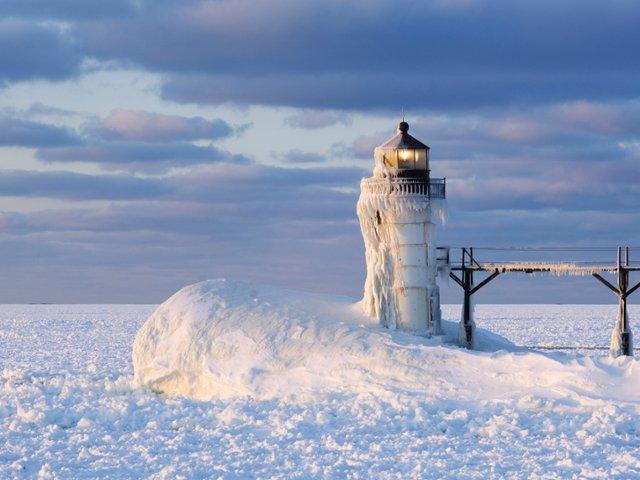 a-frozen-lake-michigan-and-st-joseph-lighthouse-michigan